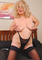 Blonde mature slut is playing with her wet pussy