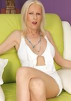 Horny mature slut masturbating on her couch