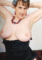 Horny big breasted mama playing with her toys