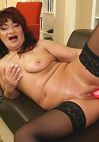 This horny mature slut loves to play with toys