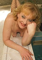 This horny mature slut loves to get wet at the pool