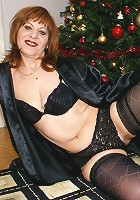 Horny housewife playing with her christmas present