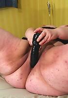 Big mama playing with herself