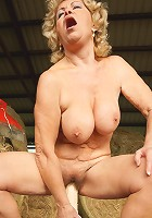 Mature slut playing with herself in a barn