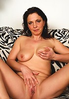 This hot mature slut plays with herself