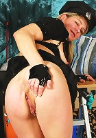 Mature female cop gets busy on the job