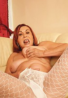 Horny housewife going at it on her own