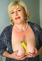 Chubby housewife playing with a cucumber