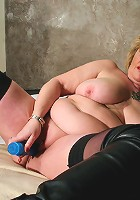 Big mama playing with her moist pussy