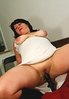 Chubby housewife enjoying her huge dildo
