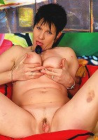 Horny mama playing with her toy