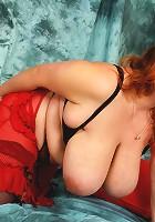 Huge breasted mature slut playing