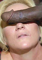 Blonde mature cunt takes on two black cocks