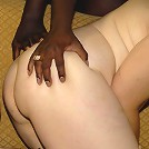 Two mature sluts sharing three black cocks