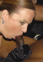 Chunky mature slut munching on a black cock