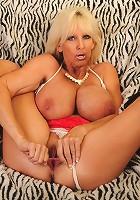 Blonde mature slut with huge boobs masturbating