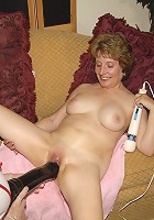 This mature dame gets fisted and dildo fucked by a naughty mature nurse