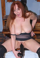This red kinky mature slut really gets wet from big toys