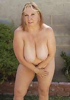 Chunky big titted mama gets a fist up her pussy