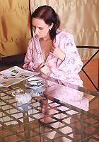 After having breakfast Anilos granny Alena gets horny and masturbates