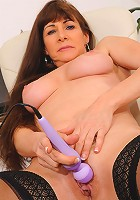 Horny Alexandra Silk pleasures her mature pussy with a purple magic wand