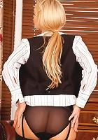 Busty milf secretary flaunts her huge melons in classy yet seductive office attire