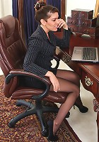 Horny office cougar rubs her boobs in her bra a she watches porn on a laptop