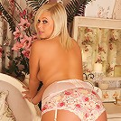 Naughty housewife Anna Joy teases with her floral panties on a classy bench