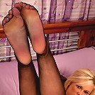 Tempting blonde MILF flaunts her sexy violet lingerie and nice huge ass