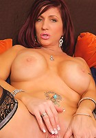 Sexy Anilos Brittany Blaze spreads her mature pussy exposing her clitoris