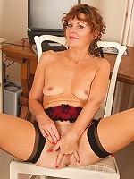 Enticing  Anilos secretary loves to finger her hot mature pussy