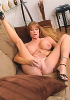 Seductive brunette Darla Crane plunges a glass dildo deep inside of her cougar fuck hole