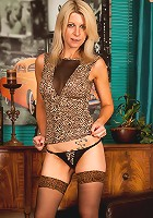Blonde cougar shows off her long sensual legs