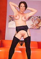 Busty mature milf Foxy bends over showing off her shaved snatch