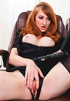 Sensual milf redhead masturbates while watching porn in the office