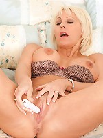 Horny cougar with huge tits masturbates with a small toy in her bedroom