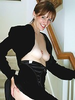 Anilos Justine flaunts her medium sized boobs as she slips off her evening wear