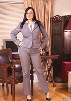 Business woman Michelle Bond slides off her office attire and reveals her massive tits