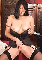 Mature milf Raven takes off her evening gown exposing her big tits and sweet pussy