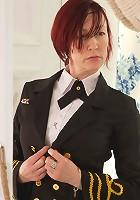 Redhead Anilos stewardess flaunts her big jugs in a bra