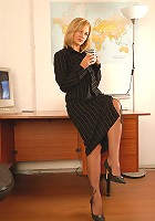 Horny office MILF Laurita from AllOver30 loosens up at the job
