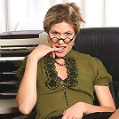 Mature office girl Delilah gets down and dirty on her desk in here