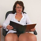 Mature brunette babe with glasses & spread shaved pussy