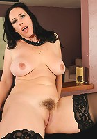 Showing off her trimmed mature pussy Kira spreads her round ass