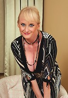 Elegant and mature Monik slips off her evening dress and spreads