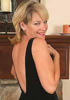 Elegant and mature blonde Tina shows off her trimmed pussy here