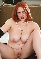 Fair skinned and redheaded MILF Wednesday spreads open her ass