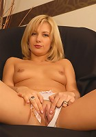 Hot blonde in bright white panties spreads her mature pussy wide