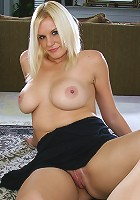 Gorgeous blonde Slovanna shows of her big tits and mature pussy