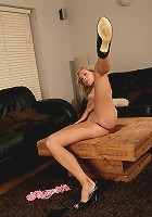 Tall and lean mature blonde spreads her wet shaven pussy here